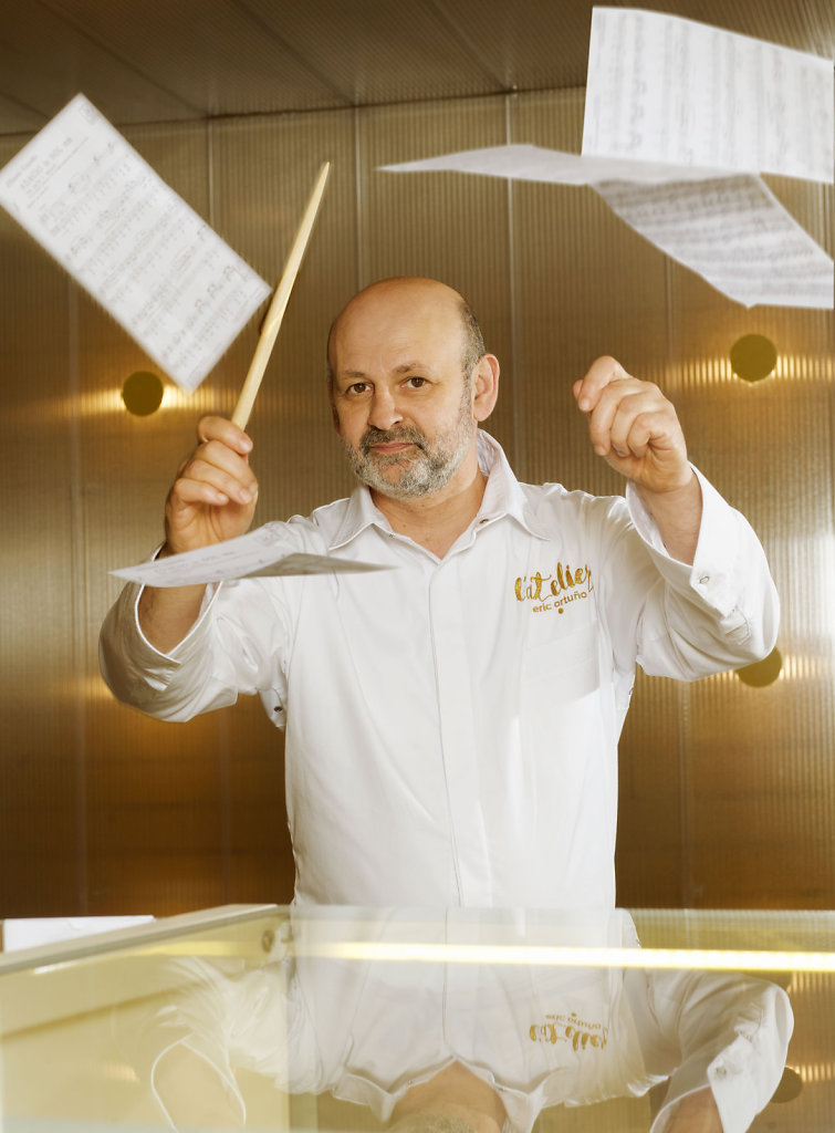 Eric Ortuño directing the orchestra